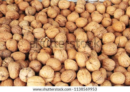 stock-photo-walnuts-on-the-market-close-