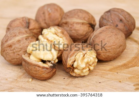 Walnuts on wood                      - stock photo