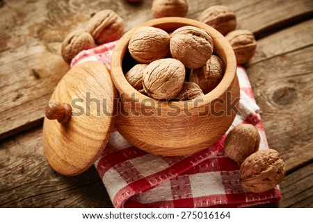 Walnuts on wooden background - stock photo