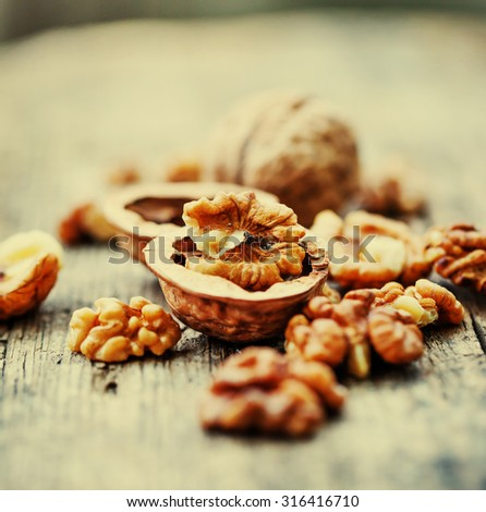 Walnuts  on wooden table / selective focus - stock photo