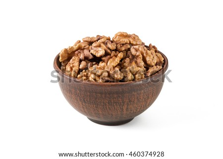 Walnuts shelled in a bowl isolated on white background. Side view. Walnut kernels in a bowl.