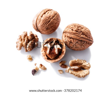 walnuts whole, half and peeled close-up  isolated on white background  - stock photo