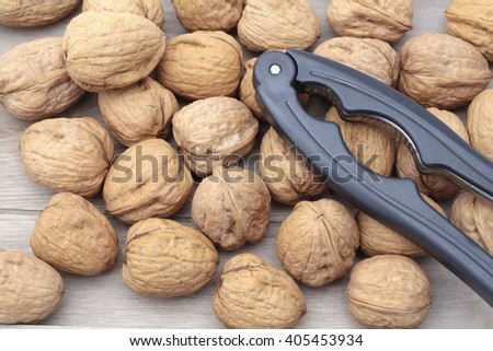 Walnuts with a nutcracker  - stock photo
