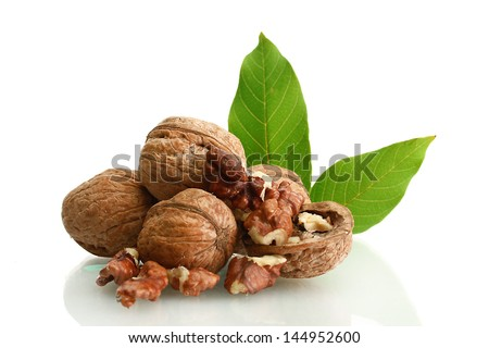 walnuts with green leaves, isolated on white - stock photo