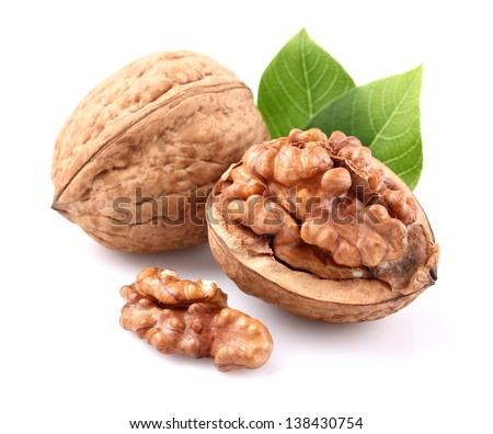 Walnuts with leaves - stock photo