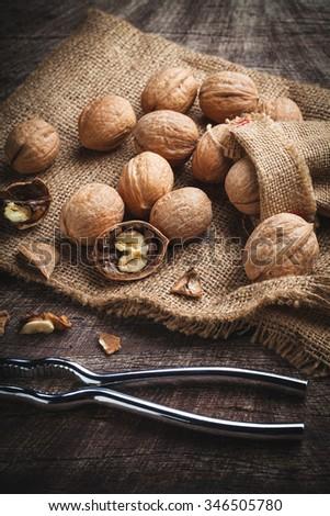 walnuts with nutcracker - stock photo