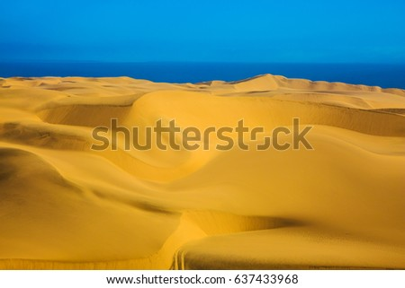 Walvis Bay, Namibia. The coast of the Atlantic. Unique giant sand dunes. The concept of extreme and exotic tourism