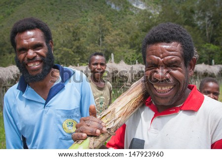 WAMENA, NEW GUINEA, INDONESIA - JANUARY 08: Unknown Papuan in everyday life in Wamena, New Guinea Island, Indonesia on January 08, 2009 - stock photo
