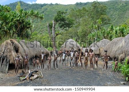 WAMENA, PAPUA, INDONESIA - November, 14: Papuan people in the traditional village on November, 14, 2008 near Wamena, Papua, Indonesia. - stock photo