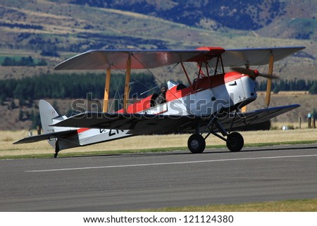 "WANAKA MARCH 03: Foker DR.1 vintage aircraft on the runway during the royal New Zealand air force 75th anniversary""Warbirds Over Wanaka"" airshow on March 03, 2012 in Wanaka New Zealand - stock photo"