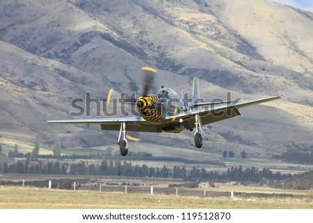 """WANAKA-MAY 03: P-51D Mustang aircraft takes off  during the royal New Zealand air force 75th anniversary """"Warbirds Over Wanaka"""" airshow on May 03, 2012 at Wanaka New Zealand - stock photo"""