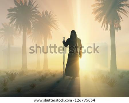 wandering monk at sunrise - stock photo