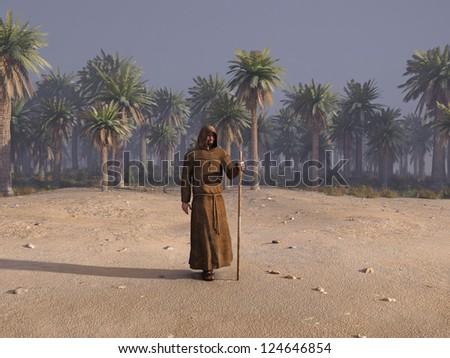 wandering monk in desert - stock photo