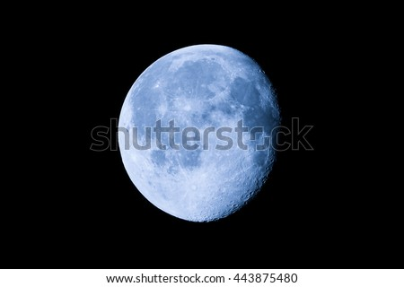 Waning moon seen with an astronomical telescope (photo taken with my own telescope, no NASA images used) - stock photo