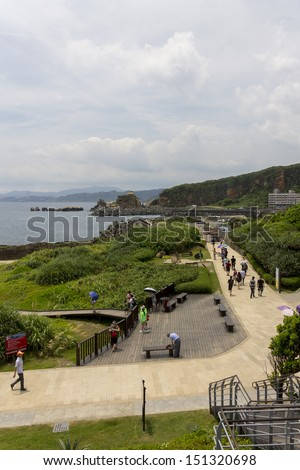WANLI, TAIWAN - JULY 7: Many people visiting on sunday july 7th 2013 famous Yehliu area with beautiful sceneries and famous rock formations created by sea.Yehliu is well known worldwide for its beauty