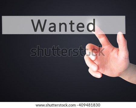 Wanted - Hand pressing a button on blurred background concept . Business, technology, internet concept. Stock Photo