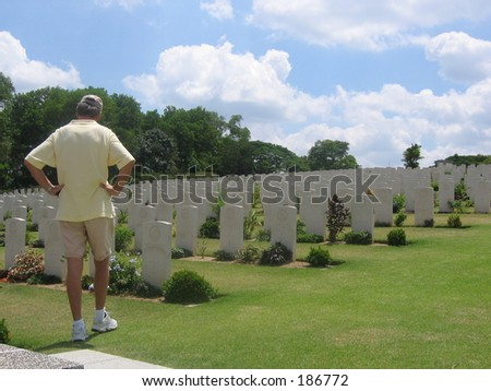 War cemetery with man visiting - stock photo