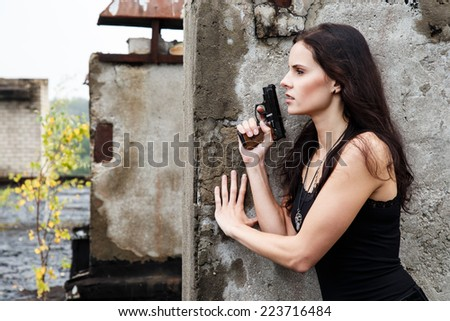 War, conflict. Female soldier with a gun - stock photo