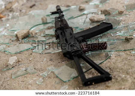 War, conflict. Rifle on the floor - stock photo