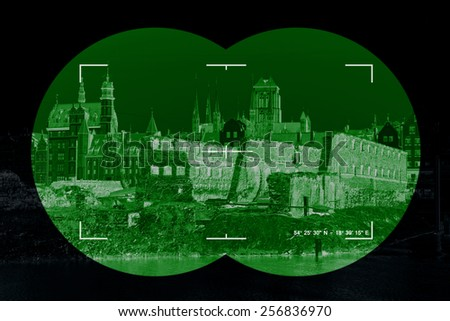 War damage ruins in Gdansk - view through the night vision device. - stock photo