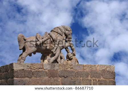 War horse crushing a enemy on clear sky - stock photo