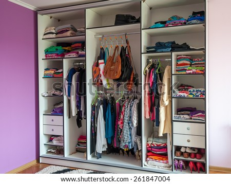 wardrobe closet clothes shoes bag in one place - stock photo