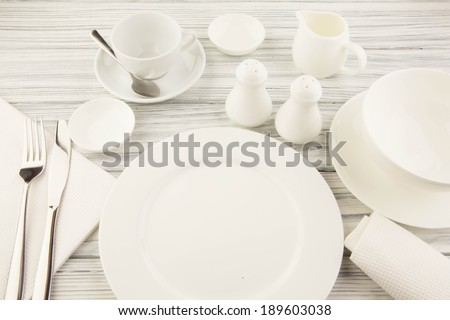 Ware for food white on a wooden table - stock photo