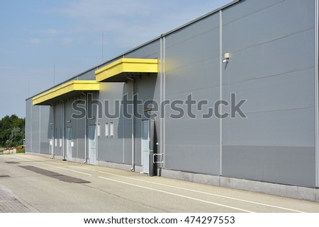 Warehouse building wall and rear entrance