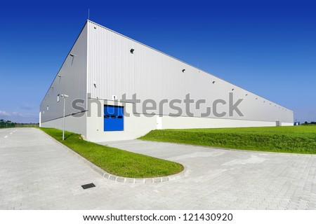 Warehouse building with blue sky - stock photo