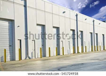 Warehouse Gates. Shipping, Storage and Cargo Industry Photo Collection. Large Warehouse Building. All Gates Closed. - stock photo
