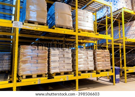 Warehouse in a mill factory with packages with flour and wheat products ready for shipping and export, arranged in shelves,Sofia Goodmills, Bulgaria, March 29, 2016.