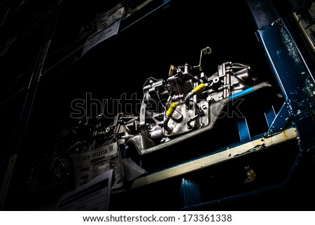 Warehouse of spare parts in car-care center - stock photo