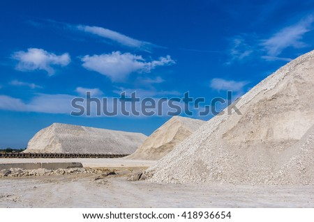 warehouse production in quarry blue clay on sky background