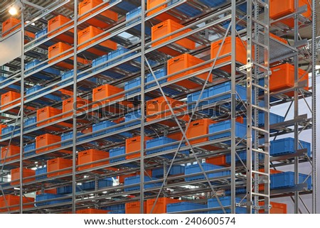 Warehouse shelving system with boxes and crates - stock photo