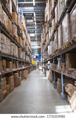 Warehouse with goods in retail merchandise shop - stock photo