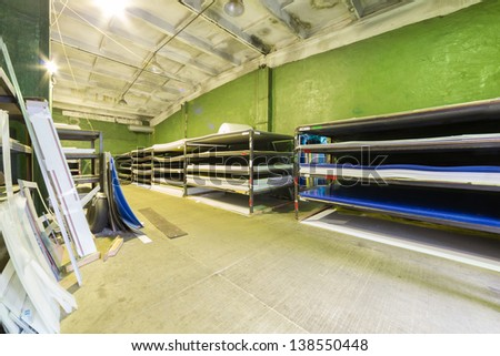 Warehouse with green walls with large plastic sheets