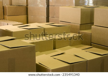 warehouse with shipping cartons and packaging  - stock photo