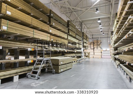 warehouse with variety of timber for construction and repair - stock photo