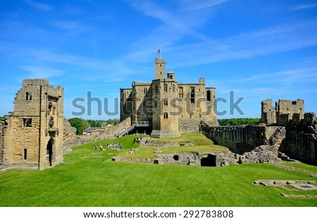 WARKWORTH, ENGLAND - JUNE 11: Castle ruins on June 11, 2015 at Warkworth, England. Warkworth has a lovely medieval castle in ruins. - stock photo