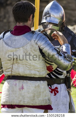 WARKWORTH, NORTHUMBERLAND, ENGLAND- AUGUST 7, 2013: Members of Plantagenet Medieval Society put on display of medieval combat. 7 August 2013. Warkworth Castle. Northumberland. England.