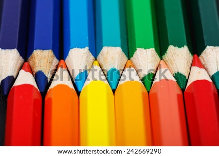 Warm and cold colours presented with colorful pencils, closeup view - stock photo