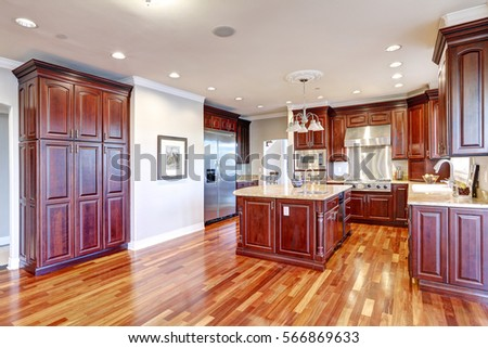 Warm And Inviting Kitchen With Large Kitchen Island, Cherrywood Cabinets,  Gold Granite Counter Tops