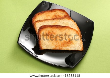 warm breakfast toast on the black plate