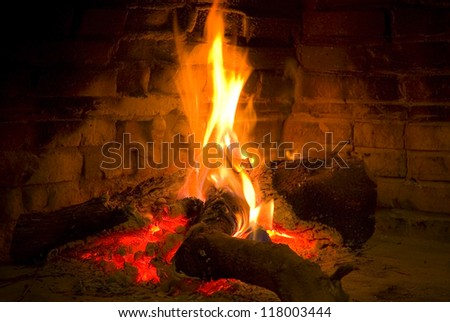 Warm bright fire in a fireplace - stock photo