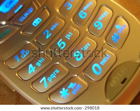 Warm Cell Phone Keypad - stock photo