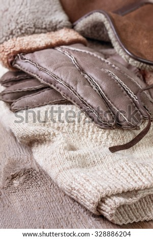 warm clothes on a wooden background