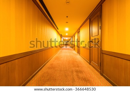 warm corridor in the hotel with old carpet - stock photo