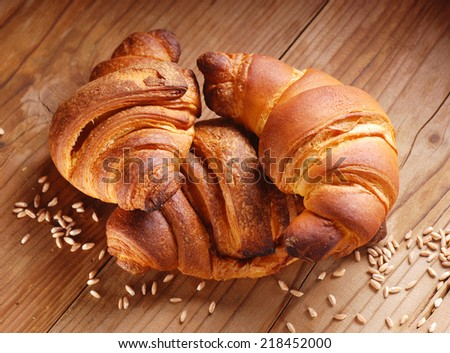 warm croissants on the wooden table