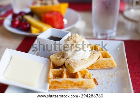 warm delicious waffles with fruits for breakfast, shallow DOF - stock photo