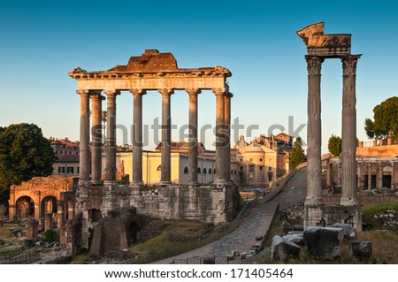 Warm early morning sunlight illuminatying the ancient ruins of the Roman Forum (6BC).